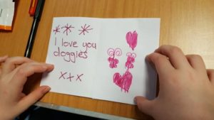 "Note saying ""I love you doggies"""