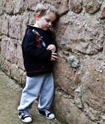 Boy against wall